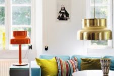 01 This colorful space with a blue sofa and colorful lamps is a part of a boho house in Sweden, though this style isn't traditional for Scandinavian countries