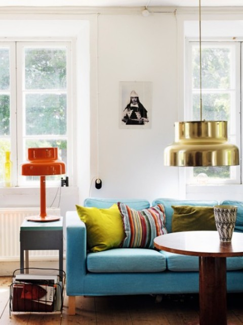 traditional scandinavian furniture. this colorful space with a blue sofa and lamps is part of boho traditional scandinavian furniture i