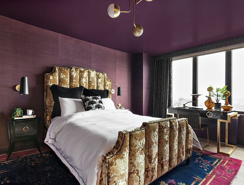 This stunning bedroom done in purple and gold is in a gorgeous art deco apartment and it's sure to take your breath away