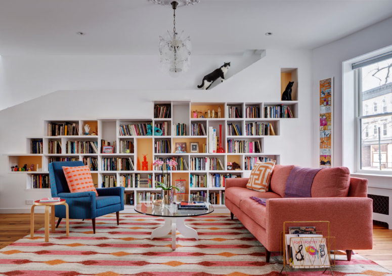 This unique and colroful house was renovated for a couple of booklovers and their two cats, and it's a perfect comfy space for all of them