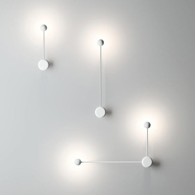 The lamps are available in black and white and you can find wall and sconce versions with similar design