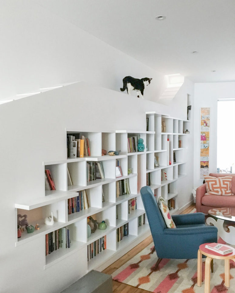 The main piece is a large bookcase, with artworks and books, plus some cat paths