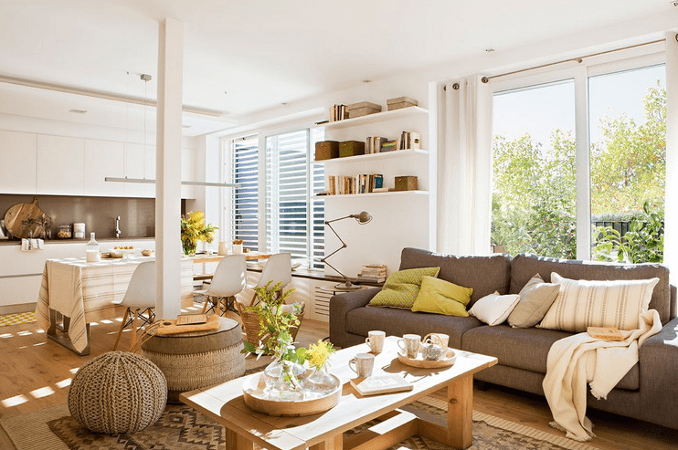 The open layout unites a living room, a dining space, a working zone and a kitchen