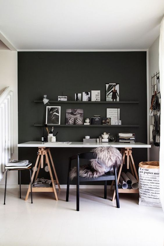 a Scandi space with a black statement wall and ledges, a trestle desk is a comfy solution