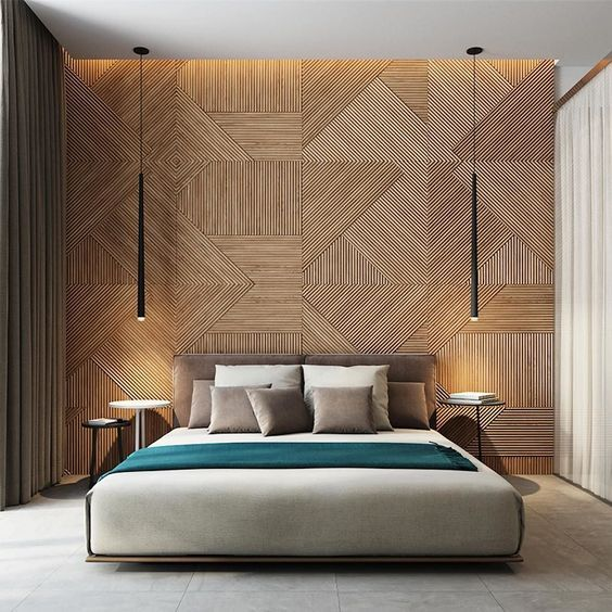 a modern space with a wood clad geometric wall, an upholstered bed and eye-catchy lamps hanging from above