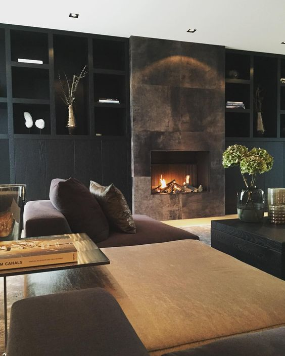 A Refined Moody Living Room With A Built In Fireplace Clad With Dark Metal  Looks