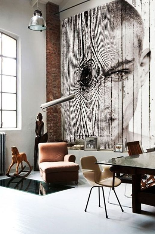 an industrial space with a wall covered with wood and a gorgeous photo art applied right to the wood
