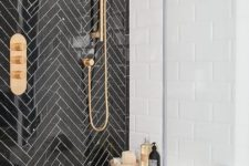 02 black herringbone tiles with white grout for accentuating the shower space and brass touches for a chic look
