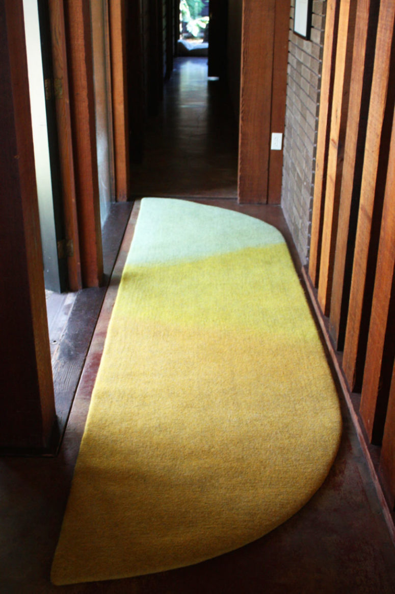 Sunrise rug imitates a natural thing and it is a fit for narrow spaces