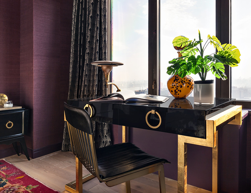 The black and gold geo desk is another eye catchy feature here, and the chair is matching