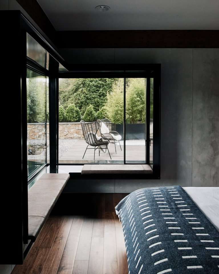 The interiors are simple and with clean lines, there are windowsill benches in the bedroom and a comfy bed plus an entry to the terrace