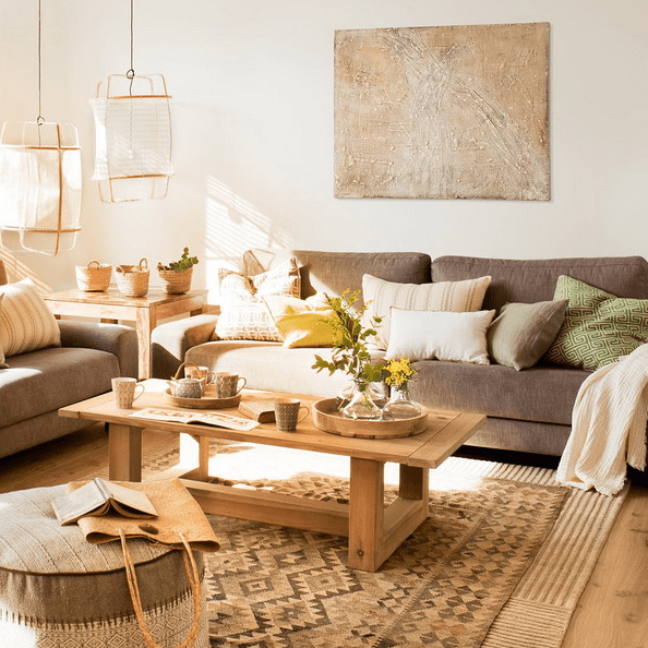 The living room features comfy furniture, wooden items and earthy tones in decor