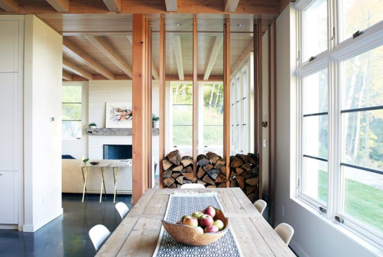 This stack adds coziness to the space reminding us that it's a winter holiday retreat plus the wood can be used for the fireplace