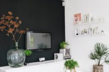 03 a Scandinavian space done in neutrals and creamy shades, and one black wall for a bold accent, some boho touches