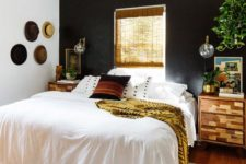 03 a boho and rustic space with a black headboard wall is balanced with warm-colored wood and a window in this wall
