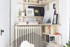 03 a cozy reading nook with a comfy chair and bookshelves over the radiator is a warm and cozy space