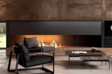 03 a luxurious living room in dark shades with a built-in fireplace and dark furniture for a cool look