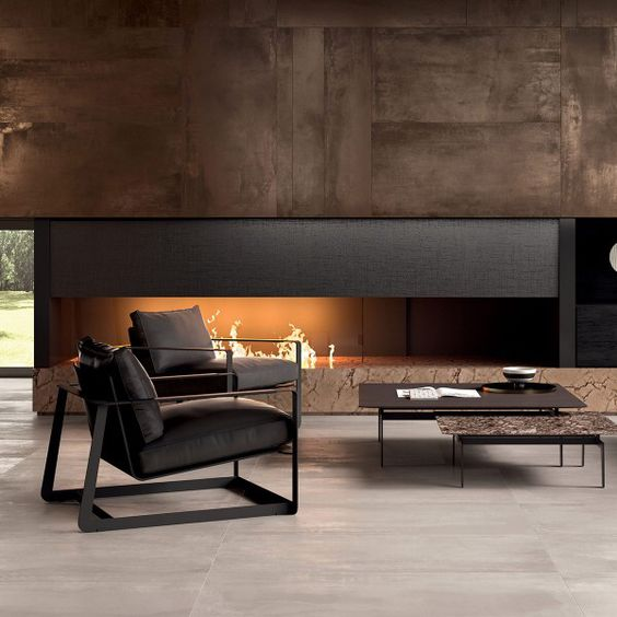 a luxurious living room in dark shades with a built-in fireplace and dark furniture for a cool look