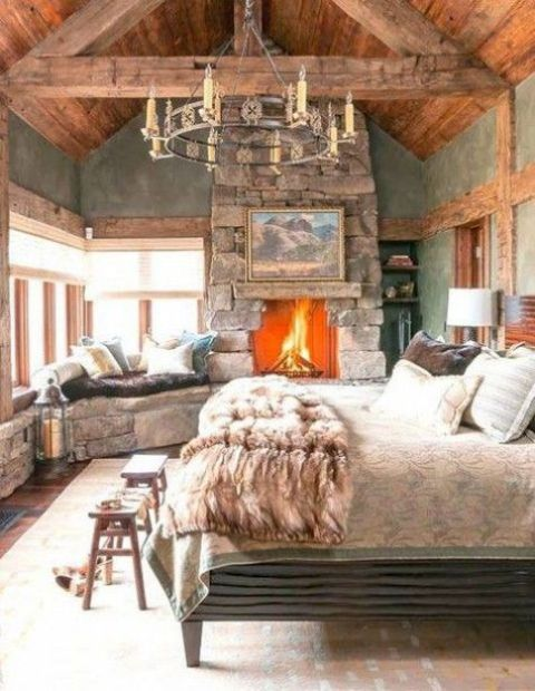 a stone clad fireplace brings coziness to this cabine bedroom and makes it welcoming