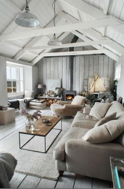 a summer house with a grey wooden wall and a white wooden sloped ceiling  for a