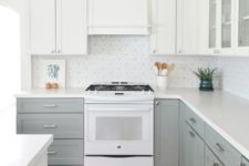 03 an ethereal kitchen with dove grey and white cabinets and a geometric tile backsplash looks very inviting