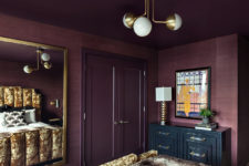 04 Brass touches here and there add chic to the bedroom and you can see a large framed mirror
