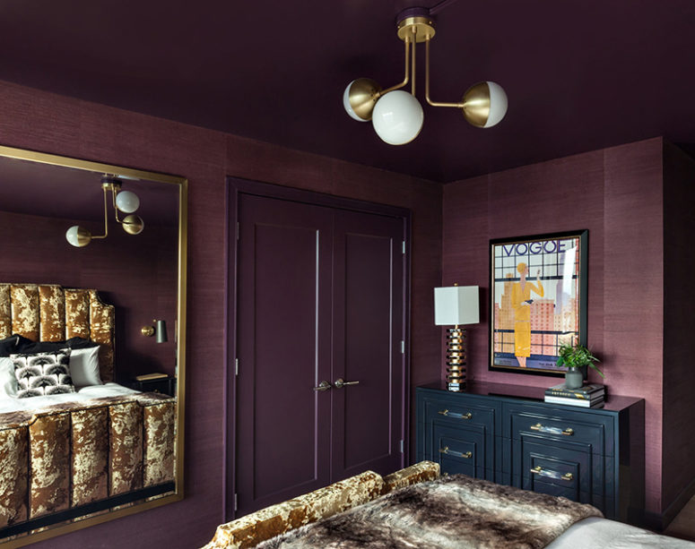 Brass touches here and there add chic to the bedroom and you can see a large framed mirror