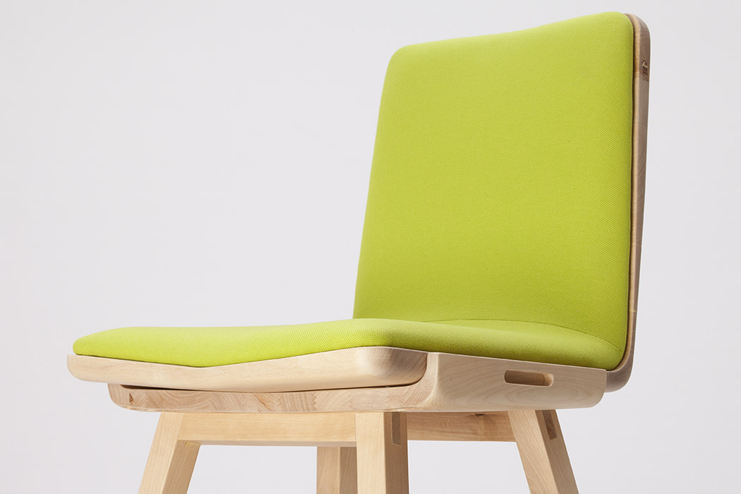 Chic fabric and a stable wooden construction make this chair awesome and timeless
