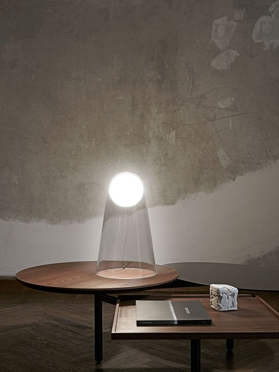 Satellight table lamp by Foscarini is sure to make a shining accent while having clear appearance