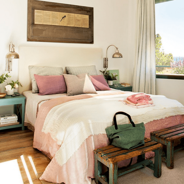 The master bedroom is furnished with shabby chic and vintage items, and the color palette is a pastel one, the views are also present