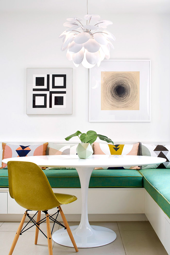 The seating bench is emerald, it adds a bold touch to the space and so does the yellow chair