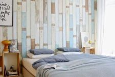 04 a light and airy bedroom with a reclaimed wood pallet wall in different shades