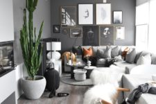 04 a modern space in neutrals with just one black wall, some desert touches and amber accessories