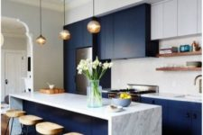 04 navy and white kitchen with marble countertops, bubble pendant lamps and comfy wooden stools