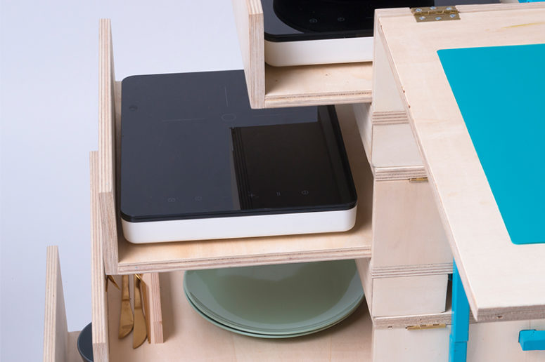 Two induction cooktops are available in drawers that include preparation space