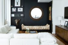 05 a chic modern space with a black wall, creamy furniture, walls and a ceiling and cool accessories and details