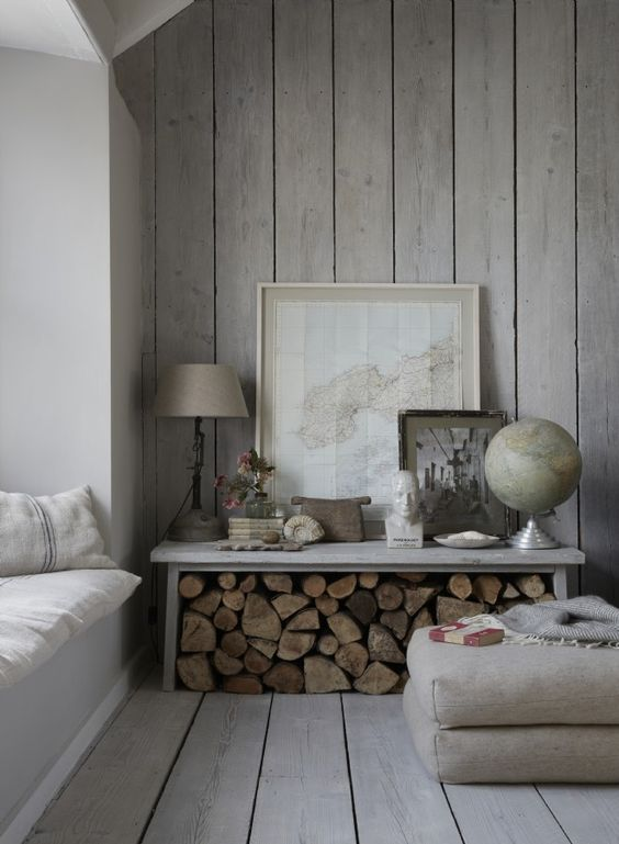 a chic whitewashed space with a wooden wall and floor looks comfy greyish and welcoming