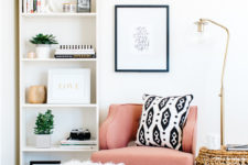 05 a cozy corner with a pink armchair, a floor lamp and some poufs is an ideal reading nook and is very inviting