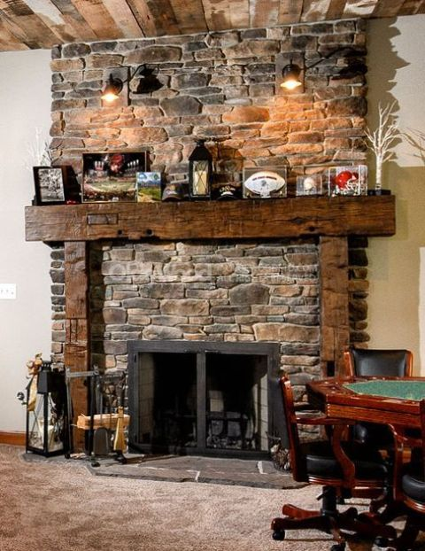 a fireplace clad with decorative stone is a classic idea, which fits any space