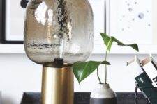 05 a smoked glass lamp with a brass base looks very chic and will give much light due to the clear glass