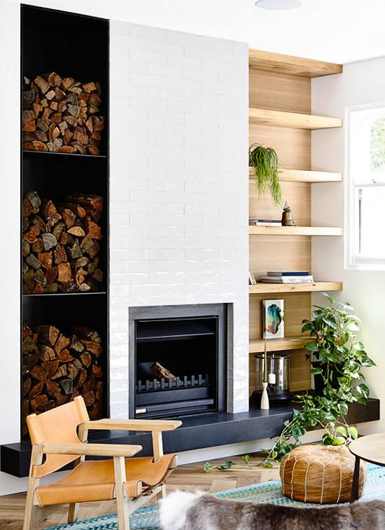 an eclectic space with a built in fireplace and lots of firewood storage for more coziness