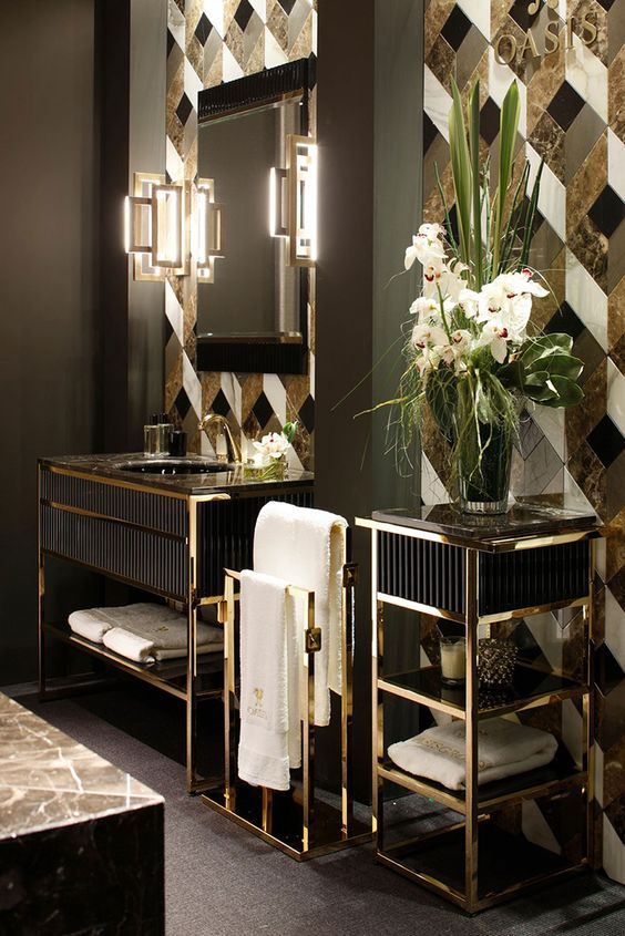 gorgeous geometric black, grey, white and gold tiles with a marble print look very chic and refined