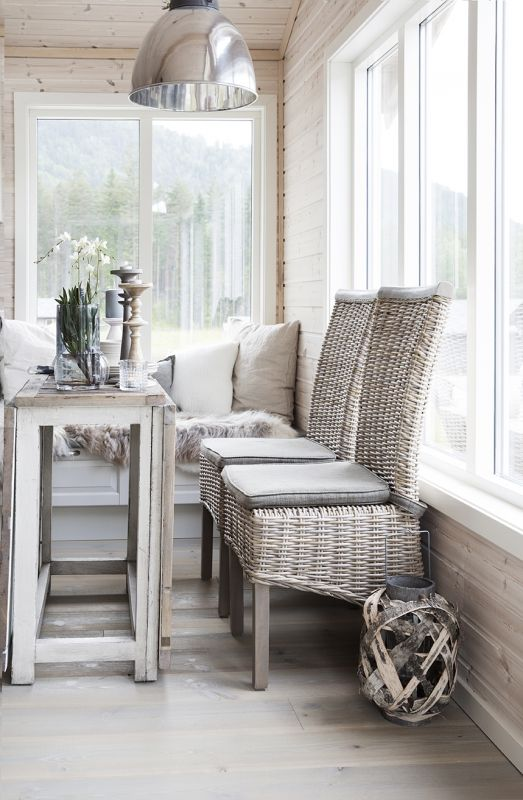grey painted wicker chairs will make your sunroom more welcoming and look relaxing
