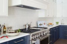 05 navy and white is a timeless combo, which never goes out of style, and a white subway tile backsplash makes the space lighter