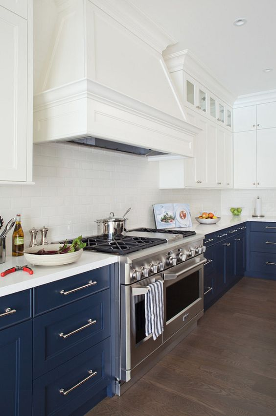 navy and white is a timeless combo, which never goes out of style, and a white subway tile backsplash makes the space lighter