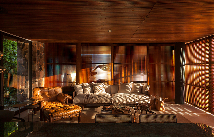 Wooden screens all around provide enough sunlight yet protect the spaces from excessive sunlight