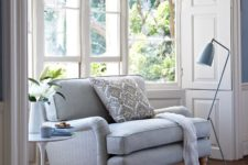 06 a corner with a comfy upholstered sofa, a side table and a matching floor lamp is a perfect reading nook