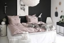 06 a girlish bedroom is calmed down with a black headboard wall, which stands out in this neutral space with blush touches