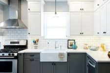 06 a graphite grey and white kitchen with stainless steel appliances and black knobs for a chic monochromatic look