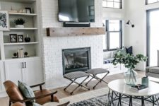 06 a neutral space with a boho feel, a built-in fireplace in a whitewashed brick wall